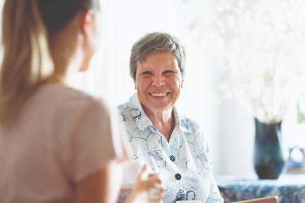 Senior woman talking with another woman